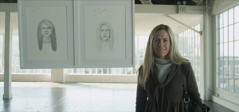 Blonde woman with portrait