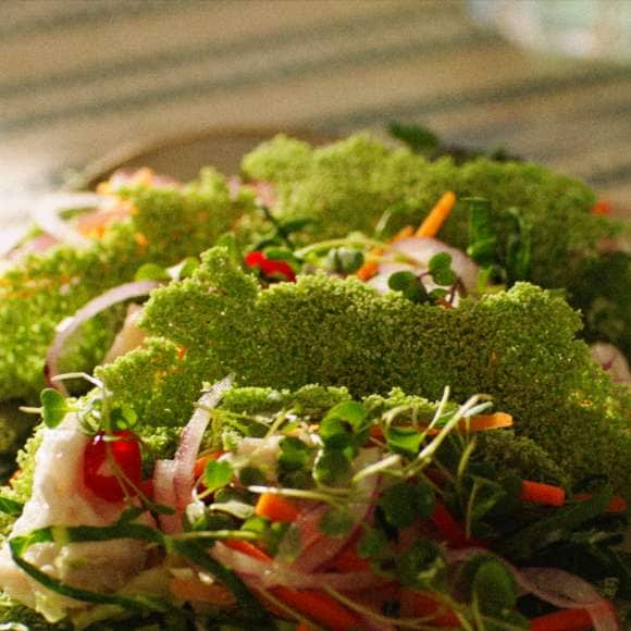 A close-up of a salad on a plate.