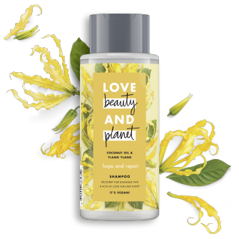Vorderseite der Shampooflasche: Love Beauty & Planet Hope & Repair Shampoo Coconut Oil & Ylang Ylang Flower