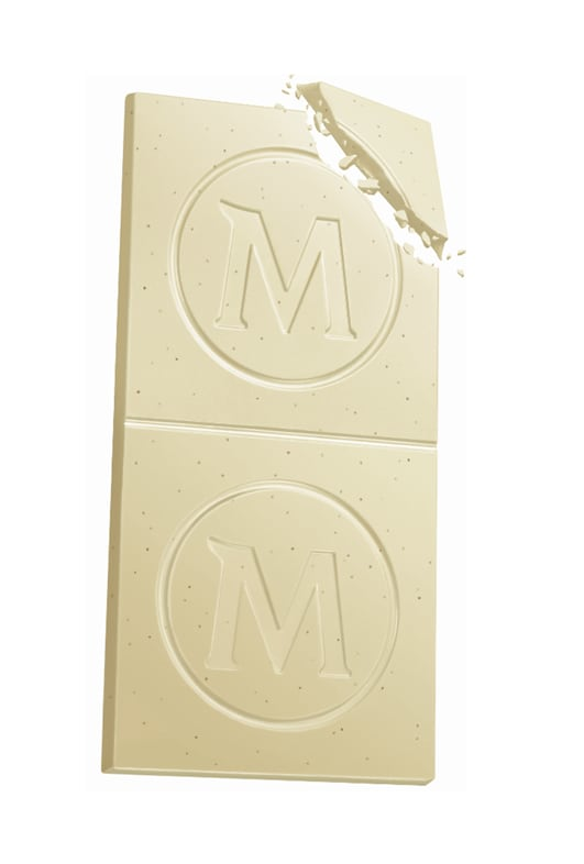 A bar of Magnum White Chocolate with the top corner broken off.