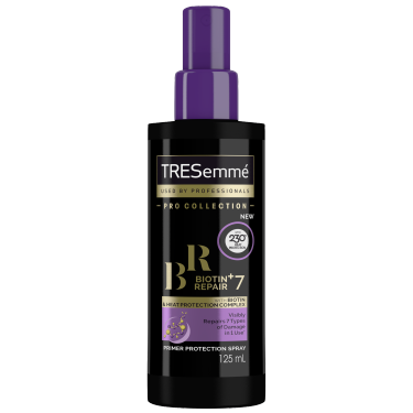 A 125ml bottle of TRESemmé Biotin + Repair 7 Heat Defence Spray front of pack